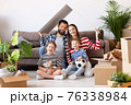 Happy family under roof in new apartment 76338984
