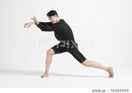 contemporary asian male dancer making move in white background 76393950