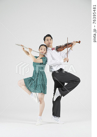 Asian couple contemporary dancers playing violin and flute 76395481