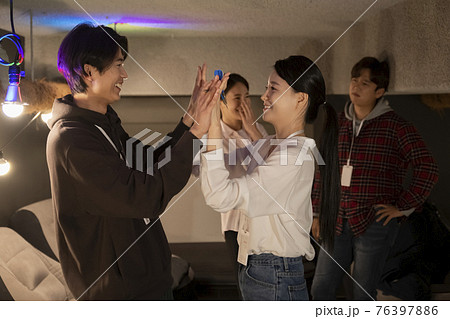 Young startup business concept playing dart game 76397886