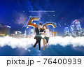 5G, Asian woman and man looking at mobile phones 76400939