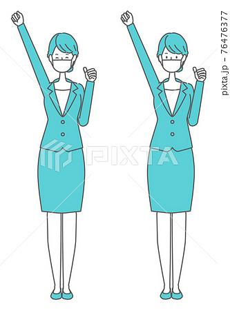 頑張る・応援する マスクを着けたスーツの女性 76476377