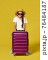 Happy little child girl in hat with pink suitcase 76484187
