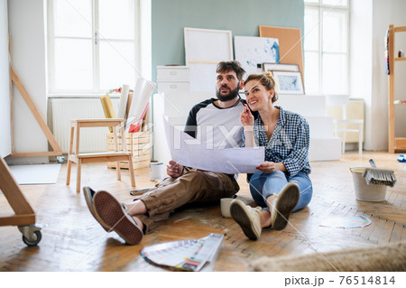 Mid adults couple planning indoors at home, relocation and diy concept. 76514814