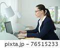 Female entrepreneur working on laptop 76515233
