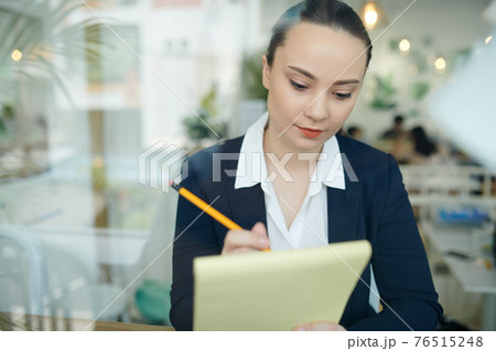 Businesswoman working on product presentation 76515248
