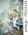 Female entrepreneur correcting document 76515249