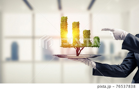 Hand of waitress presenting growing graph on tray. 76537838