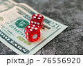 The dice are on the banknote in the casino. Money rate in gambling 76556920