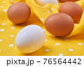 Close-up raw easter eggs. White and brown eggs. 76564442