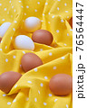 Close up still life white and brown eggs. 76564447