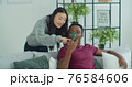 Man show explain to beloved girl new app resting at home spend time together use wireless tech. Discuss media news, generation modern devices everyday overuse concept. 76584606