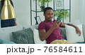 Man show explain to beloved girl new app resting at home spend time together use wireless tech. Discuss media news, generation modern devices everyday overuse concept. 76584611