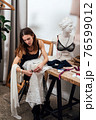 Female lingerie designer works in her workshop. 76599012