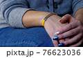 Female hand with vaccined bracelet or label after injection 76623036