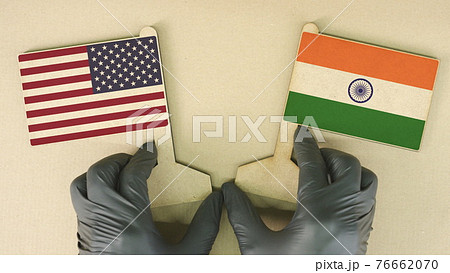 Flags of the USA and India made of cardboard on the desk 76662070