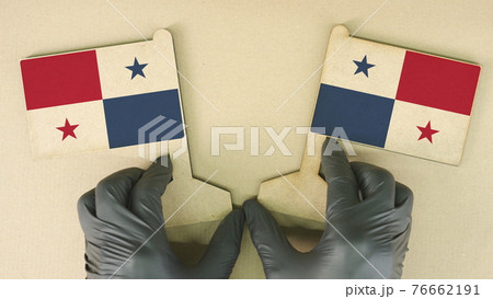 Flags of Panama made of recycled paper on the cardboard table 76662191