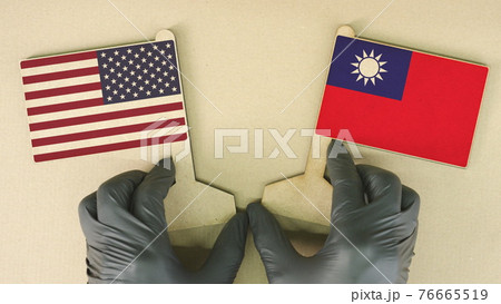 Flags of the USA and Taiwan made of recycled paper on the cardboard table 76665519