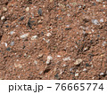 orange grunge plaster texture with multi color grit and stones grain background 76665774