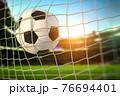 Goal. Soccer football ball scores a goal on the net. 76694401