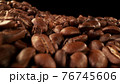 Pile of fresh roasted coffee beans with 76745606