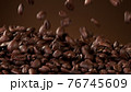 Falling roasted coffee beans 76745609