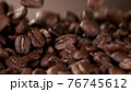 Falling roasted coffee beans 76745612