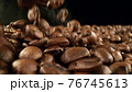 Falling roasted coffee beans 76745613
