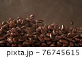 Falling roasted coffee beans 76745615