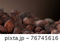 Pile of roasted cocoa beans 76745616