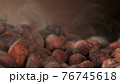 Pile of roasted cocoa beans 76745618
