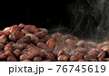 Pile of roasted cocoa beans 76745619
