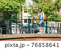 Happy young woman in european city 76858641
