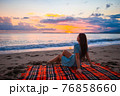 Woman on the beach enjoying summer holidays looking at the sea 76858660