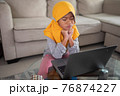 unhappy muslim young kid while studying from home 76874227