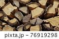 Oak firewood is dried in a woodpile 76919298