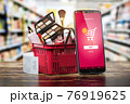 Cosmetics and beauty products buying online concept. Shopping basket with makeup products and mobile phone on shelf of cosmaetics shop. 76919625