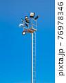 Pole with spotlights and CCTV camera at a ski resort. 76978346