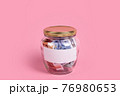 Euro banknotes in glass money jar with blank label, financial, saving. Money box with empty sticky note paper. Jar full of cash, save money concept, expense planning and control, free space for text 76980653