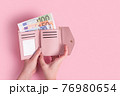 Hands holding wallet. Pink leather wallet with euro money in female hands. Closeup on a woman's hands taking European bank notes out of purse. Concept of money, finances, shopping, cash. Free space. 76980654