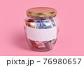 Euro banknotes in glass money jar with blank label, financial, saving. Money box with empty sticky note paper. Jar full of cash, save money concept, expense planning and control, free space for text 76980657
