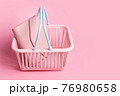 Colorful plastic shopping baskets with leather wallet. Empty pink and blue supermarket basket on pink pastel background. Creative design, shopping, black friday, discount, advertising, sale concept. 76980658