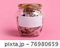 American dollars in glass money jar with blank label, financial, saving.Money box with empty sticky note paper. Jar full of cash, save money concept, expense planning and control, free space for text 76980659