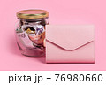 Euro banknotes in glass money jar with blank label and pink wallet, financial, saving. Money box with empty sticky note paper. Jar full of cash, save money concept, expense planning and control 76980660