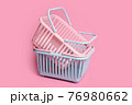 Colorful plastic shopping baskets. Empty pink and blue supermarket baskets on pink pastel background. Creative minimalist design, online shopping. Black friday, discount, advertising and sale concept. 76980662