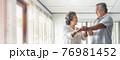 Cheerful Smiling Asian Senior couple dancing 76981452