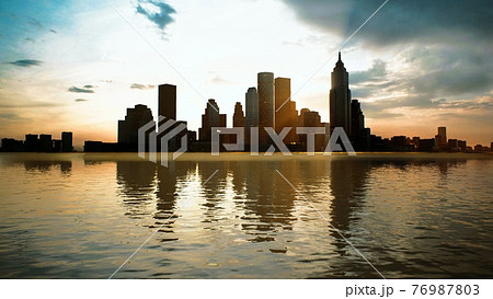 Skyline with skyscrapers and sea at sunset 76987803