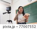 Asian woman teacher using digital camera online teaching 77007552