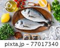 Uncooked dorado fish on wooden tray 77017340