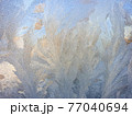 frosty patterns on the window glass. natural textures and backgrounds. ice patterns on frozen 77040694